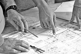 Architect and Builder Reviewing Construction Plans - 275px